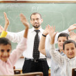 Stock Photo: Education activities in classroom at school, happy children learning