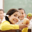 Education activities in classroom at school, happy children learning — Stock Photo #8845580