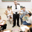 Education activities in classroom at school, happy children learning — Stock Photo #8845585