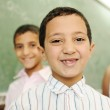 Education activities in classroom at school, happy children learning — Stock Photo