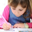 Happy little girl drawing with pencils at home — Stock Photo
