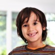 Happy cute boy without front tooth, prepared for the school — Stock Photo #8845682
