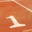 Numbers on running track, one 1 for winner — Stock Photo #8845908