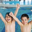 Summertime and swimming activities for happy children on the pool — Photo