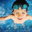 Summertime and swimming activities for happy children on the pool — Stockfoto