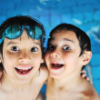 图库照片: Summertime and swimming activities for happy children on pool