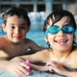 Summertime and swimming activities for happy children on the pool — 图库照片