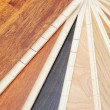 Top samples of various color palette - wooden floor — Stock Photo