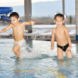Beautiful childhood moments on swimming pool - Stock Photo