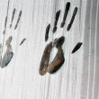 Handprints on the glass - Stock Photo