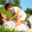 Scene of family happiness on beautiful green meadow — Stock Photo