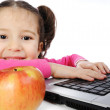 Little girl with laptop — Stock Photo #8847306