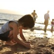 Kid on beach in sand playing, around, summer hot nice time — Stock Photo #8847347