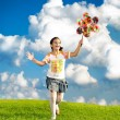 Fantastic scene of happy little girl running and playing carefreely - Stock Photo