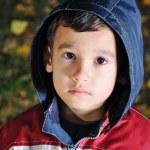 Little cute sad kid outdoor — Stock Photo
