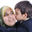 Muslim woman kissing her son — Stock Photo