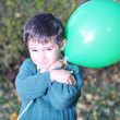 Happy positive cute kid outdoor, fall period — Stock Photo