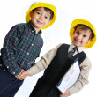 Little cute engineers isolated, kids playing together — Stock Photo #8847768