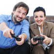Stock Photo: Couple playing videogames with some enthusiasm