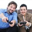 Couple playing videogames with some enthusiasm - Stock Photo
