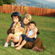 Happy muslim family on green meadow — Stock Photo