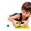 Boy playing and learning in isolated background — Stock Photo