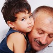 Grandfather holding his lovely boy isolated — Stock Photo