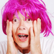 Senior woman with pink hair and facial gesture — Stock Photo