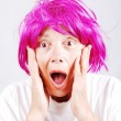 Foto de Stock  : Senior womwith pink hair and facial gesture