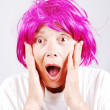 Senior womwith pink hair and facial gesture — Foto Stock #8848212