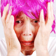 Senior woman with pink hair and facial gesture — Stock Photo #8848214