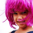 Little cute kid with pink hair and facial gesture — Stock Photo #8848215