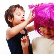 Stock Photo: Two cute kids with pink hair and facial gesture