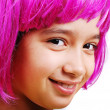 Adorable girl with pink hair and facial gesture - Stock Photo