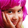 Adorable girl with pink hair and facial gesture — Stock Photo #8848229