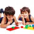 Children playing with cubes in white isolated space — Foto de Stock
