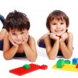 Children playing with cubes in white isolated space — Stock Photo