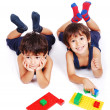 Children playing with cubes in white isolated space — Stockfoto