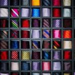 Many shelfs, fashion colored ties — Stock Photo