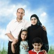 Stock Photo: Muslim Arabic family of four members outdoor