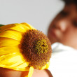 Melancholy on scene, cute girl with dry sunflower — Stock Photo