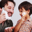 Father is teaching his boy how to shave — Stock Photo
