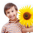 Very cute boy hugging sunflower as friend — Zdjęcie stockowe