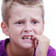 Stress expression on little blond kid's face — Stock Photo