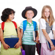 School children with bags and books, isolated — Stock Photo