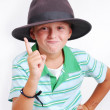 Cute school boy with hat and green shirt isolated — Stock Photo