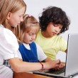 Stock Photo: Children activities on laptop put on desk, isolated