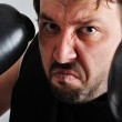 Young man with black boxing gloves — Stock Photo #8848780