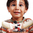 Royalty-Free Stock Photo: Very cute kid is about to eat very sweet mixed fruint and cream