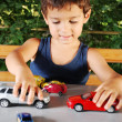Children playing with cars toys outdoor in summer time — Foto Stock
